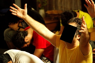 A Christian man who lives in Iran cries out to God during a time of prayer and worship