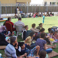 Christian refugees from Mosul, Iraq take refuge in a church courtyard in Erbil. Churches in the region have taken in many of the refugees who were forced to flee their homes when Islamic State overran Mosul in July.