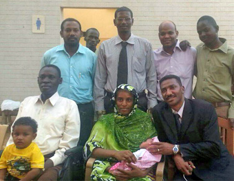 Meriam Ibrahim, her husband, and their two children are surrounded by part of their legal team shortly after her release on June 23. Five of her defense attorneys have been banned from leaving Sudan and may lose their license to practice law.