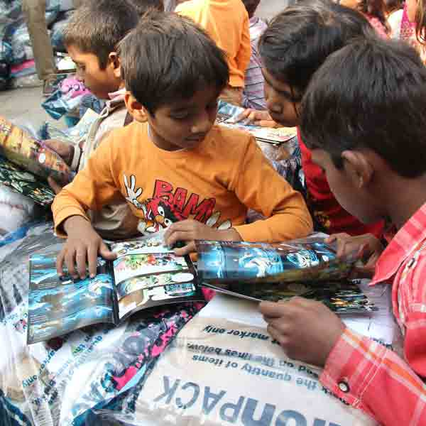 Pray the smog will lift soon so children like these can receive Action Packs.