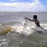 A new Rohingya convert is baptized.