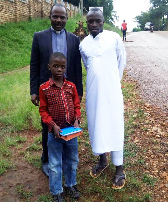 Darweshi and his pastor during a pastoral visit.