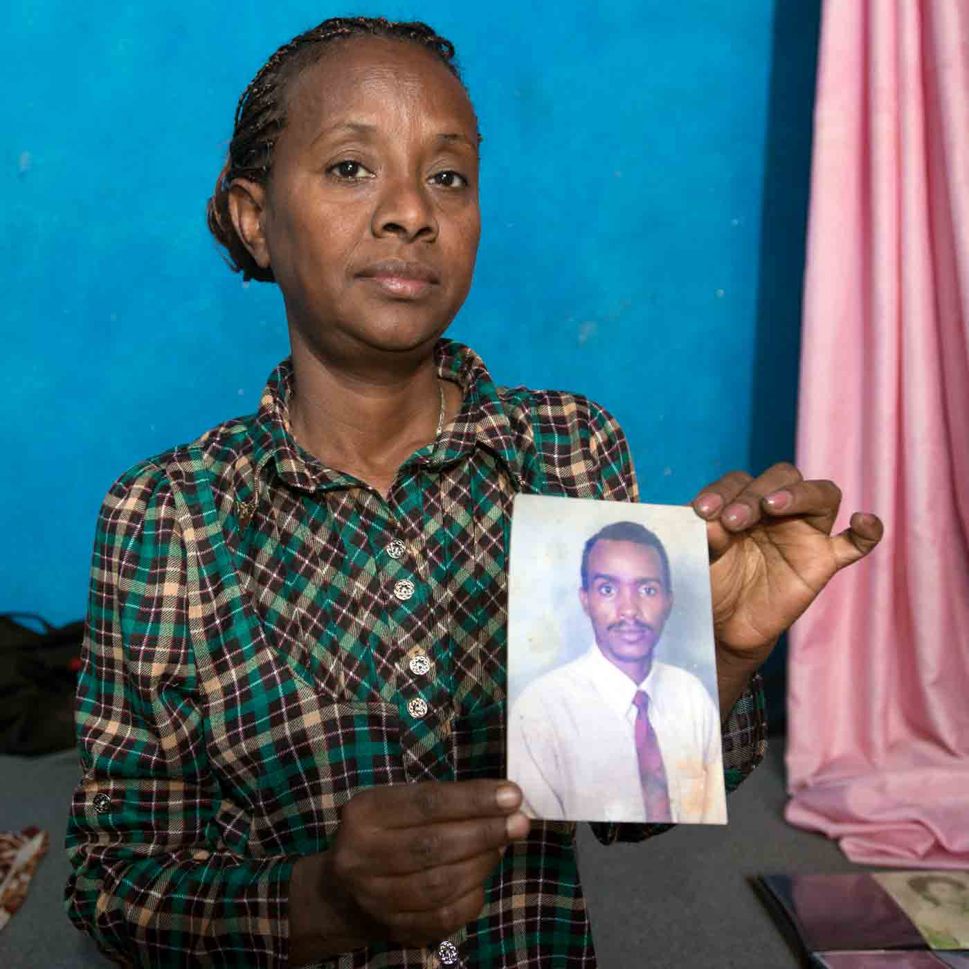 Mulu was arrested while attending a secret church meeting. Her husband died in prison.