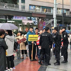 Police confronted Early Rain church member who were evangelizing on the street.