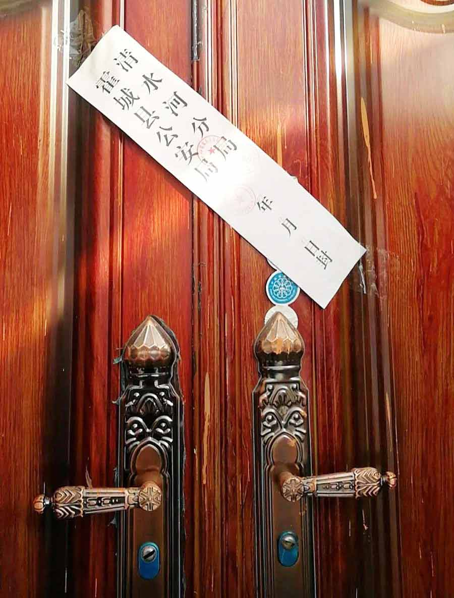 Multiple churches throughout China have been closed, such as this one with an official seal pasted across the doors.