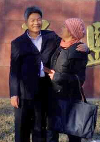 Released from prison in China on Dec. 18, Wenxi Li is greeted by his wife.