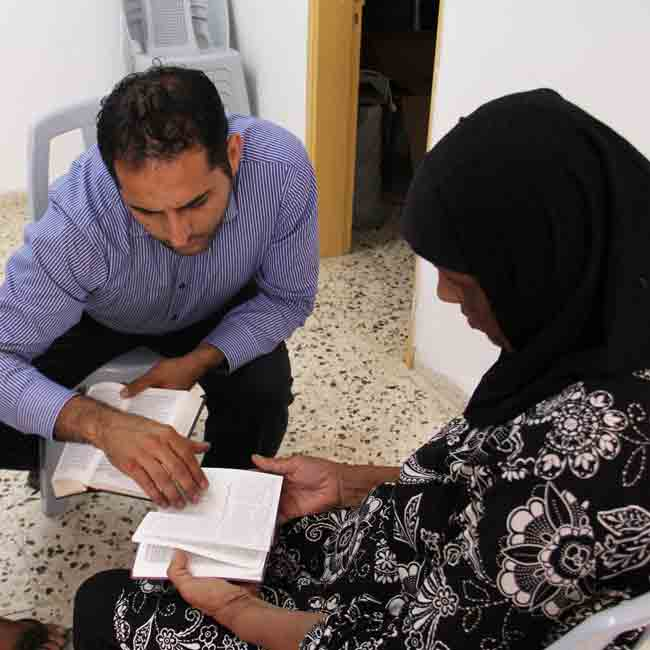 A minister meets with a woman in the West Bank to study Scripture.