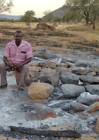 A pastor sits among the ruins of a church that was bombed in the Nuba Mountains, Sudan.