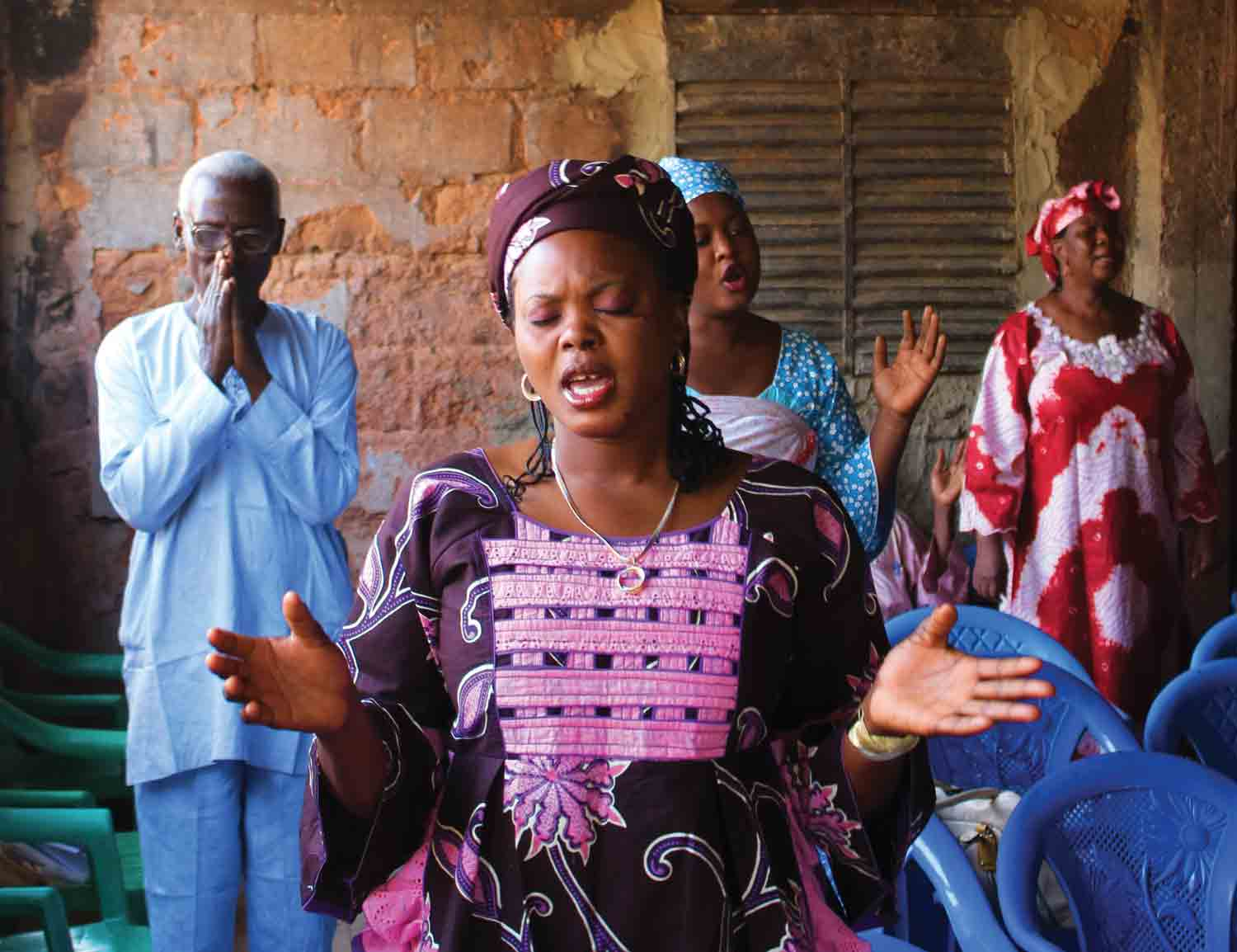 Christians in Niger worship in their church after it was attacked and burned.