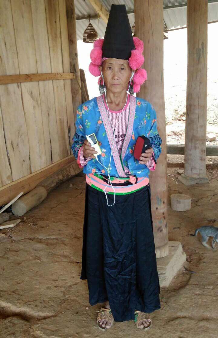 A Hmong woman who received an audio Bible.