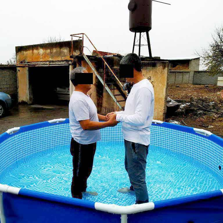 A Central Asian believer is baptized in a pool.
