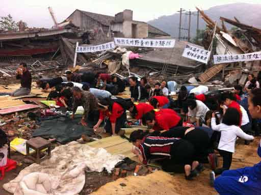 Christians worship in the rubble of a destroyed church. (Photo: China Aid)