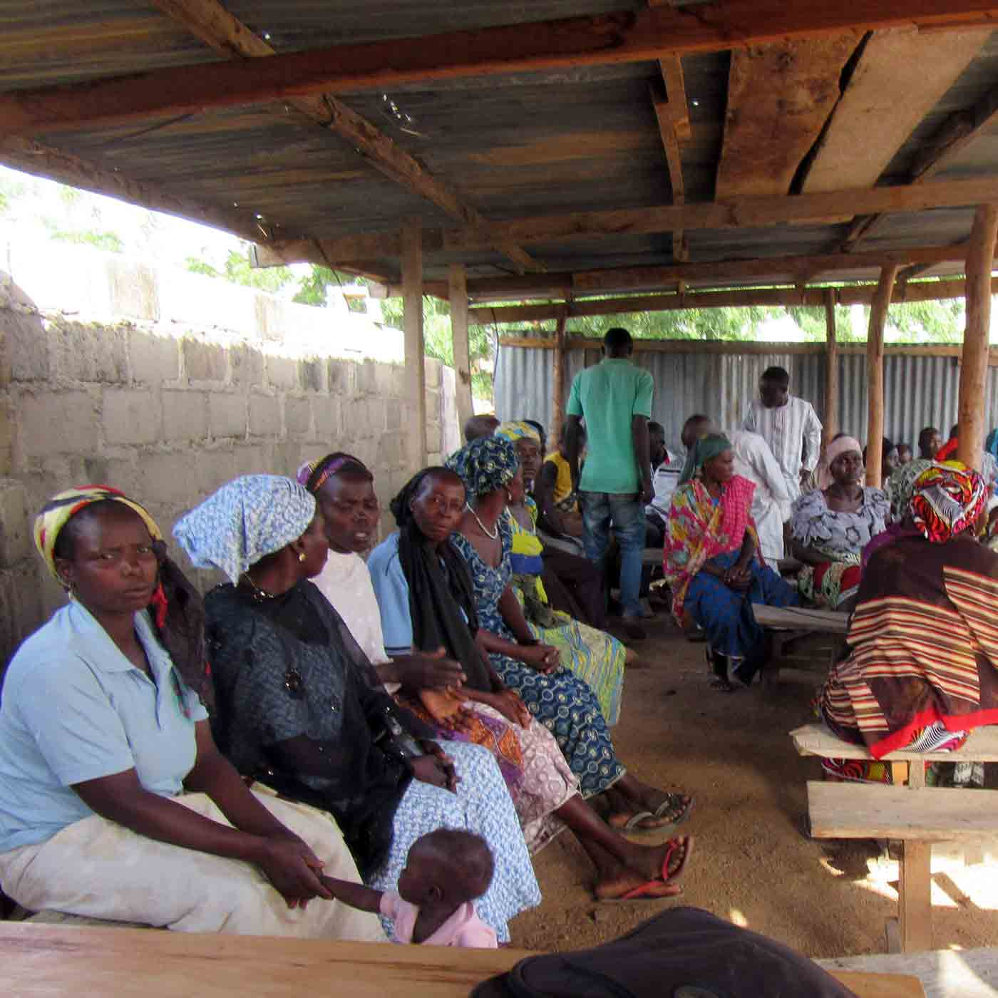 Displaced Nigerian Christians await a food distribution.