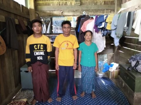 Maung Cia (middle) and his family were one of five families kicked out of their village after they participated in a worship service.