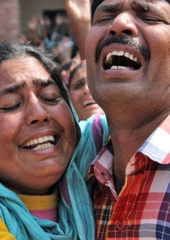Christians in Pakistan mourn after two churches were attacked by suicide bombers on March 15.