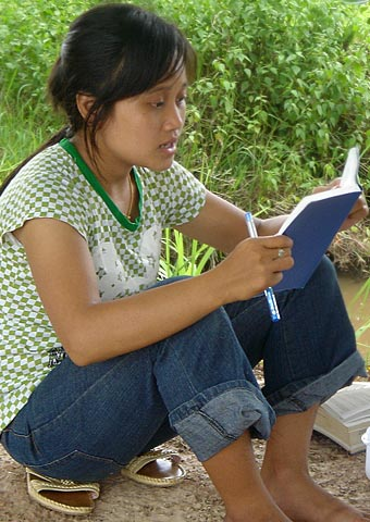 A Christian teen from Laos reads her Bible
