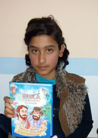 One of the children in Albania who received a VOM-sponsored children's Bible