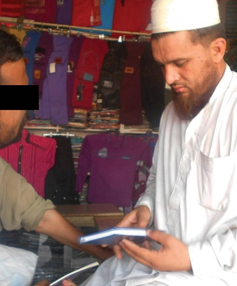 A Muslim man meets with a Christian worker