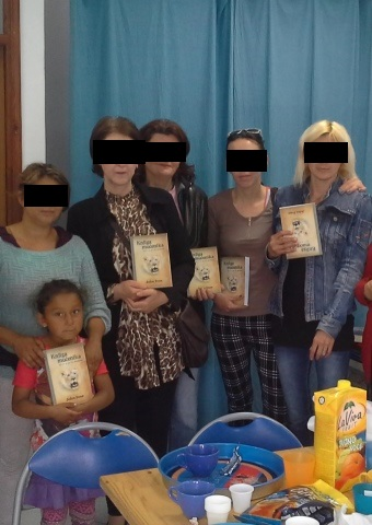 A group from Bosnia holds Christian literature recently distributed there by Christian workers.