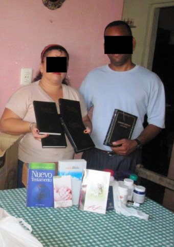 Christians in Cuba display some of the Bibles and Christian books they were given.
