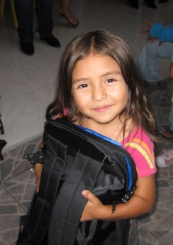 A young girl from Colombia who received a Christmas Care pack.