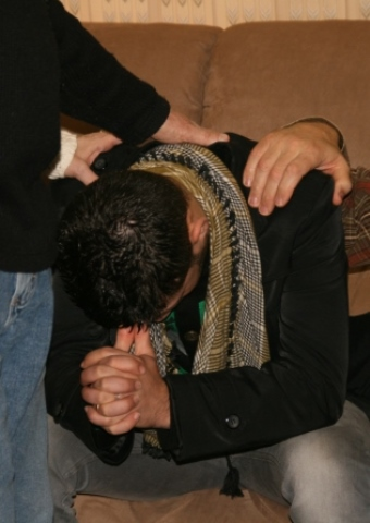 A Christian worker in the Arabian Peninsula receiving prayer.