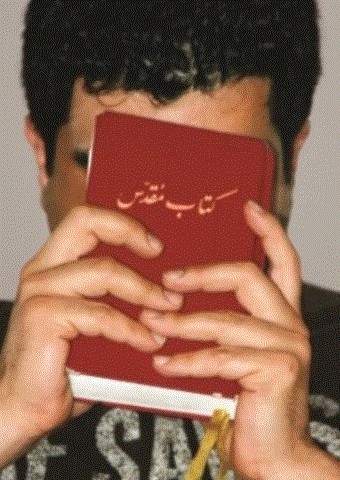 An Iranian man with his Bible.