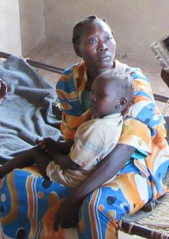 A mother and child in Sudan who received aid.
