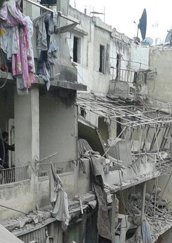 An attack on a neighborhood in Aleppo caused damage to many homes.