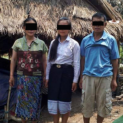Koewynn and his family in front of their shelter.